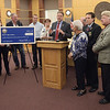 TIM JEAN/Staff photo<br /> <br /> Gov. Chris Sununu, center, speaks at the Derry Municipal Center with Derry state reps, town councilors, and school board members during a brief presentation about money the town will receive from the state's budget.  10/8/19