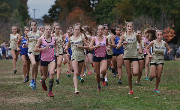 MIKE SPRINGER/Staff photo<br /> Runners start out in the girls race during a cross country meet Wednesday between Methuen, Haverhill and Tewksbury at Methuen. <br /> 10/16/2019