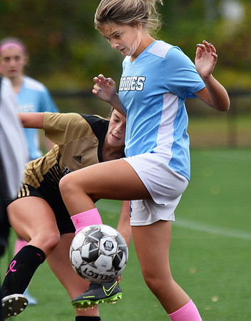 CARL RUSSO/Staff photo Haverhill's Meggie Dellea battles for the ball. Haverhill defeated Dracut 2-1 in girls soccer action Tuesday afternoon. 10/8/2019