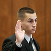 MIKE LABELLA/ Staff photo<br /> Owen Foote, 20, of Methuen, raises his right hand to be sworn in during a change of plea hearing in Haverhill District Court on Tuesday.