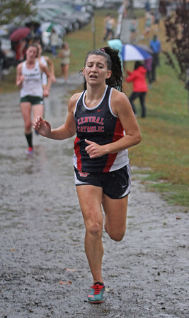 MIKE SPRINGER/Staff photo<br /> Lily Angluin crosses the finish line for Central Catholic in a cross country meet Wednesday with Haverhill and Billerica at Winnekenni Park in Haverhill. <br /> 10/02/2019