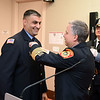 RYAN HUTTON/ Staff photo<br /> Reading Fire Chief Gregory Burns, right, pins the 2019 First Responders Award to the uniform of firefighter John Keough in the Community Room of the Reading Public Library on Monday, October 28.