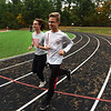 RYAN HUTTON/ Staff photo<br /> Pinkerton Academy cross country runners Stephen Connelly, left, and Luke Brennan, right, warm up on the school's track on Wednesday.