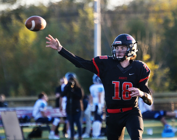 CARL RUSSO/Staff photo North Andover's quarterback Peter Radulski makes the pass. North Andover defeated Dracut 41-14 in football action.10/18/2019
