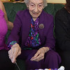 TIM JEAN/Staff photo<br /> <br /> Gelsomina Palese, of Methuen, cuts a piece of her birthday cake with her family on Saturday. Palese will observe her 101st birthday on Monday, Oct. 21.    10/19/19