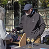 TIM JEAN/Staff photo<br /> <br /> Brian Parker, of Andover, helps a customer at the Willow Spring Vineyards wine table display on the last day of the season for Andover's Farmers Market. The market was held at the Andover Center for History & Culture on Main St., and will will open next year in a new location at South Church. 10/19/19