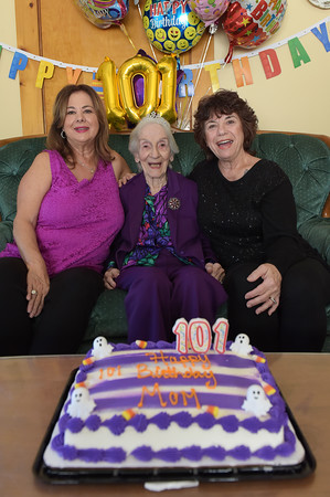 TIM JEAN/Staff photo<br /> <br /> In center, Gelsomina Palese, of Methuen, celebrates her 101st birthday with her daughters Linda Corneau, left, and Donna Hopler, with balloons and a birthday cake. 10/19/19