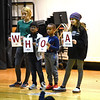 RYAN HUTTON/ Staff photo<br />  Fro left, High Plains Elementary School students fifth grader Adelaide Buzay, second grader Akshanan Thiraviyarajah, first grader Maxwell Njenga, and fifth grader Rayna Cozzaglio stand on stage during an anti-bullying assembly on Friday.
