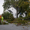 TIM JEAN/Staff photo<br /> <br /> Methuen tree department workers removed a large tree limb that fell across Weybossett St. High winds and rain overnight caused major damage throughout the Merrimack Valley.     10/17/19