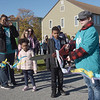 TIM JEAN/Staff photo<br /> <br /> Delany MacLeod, 11, of Haverhill, cuts the starting ribbon for the Samaritans of Merrimack Valley 3rd annual Walk for Hope. 10/19/19