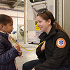 TIM JEAN/Staff photo<br /> <br /> Zoe Ramirez, 5, of Lawrence, listens to the heart beat of Lawrence General Hospital EMT Jessica Poirier during Lawrence Fire Department open house Saturday morning.   10/12/19