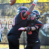 CARL RUSSO/Staff photo North Andover's Ricky Brutus, left celebrates with captain Freddy Gabin after Gabin scored a touchdown. North Andover defeated Dracut 41-14 in football action.10/18/2019