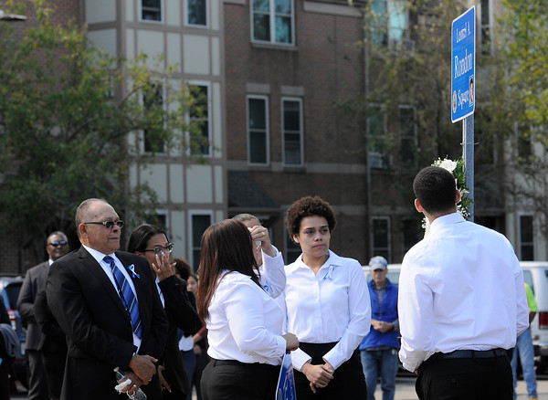 TIM JEAN/Staff photo<br /> <br /> The family of Leonel Rondon look up towards the sign they unveiled during a dedication ceremony for Rondon Square. The square is on the corner of Chestnut and Jackson St., Lawrence not far from where Leonel Rondon had lived. Rondon was the single fatality in the Sept. 13, 2018 gas disaster.  9/13/19