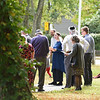 RYAN HUTTON/ Staff photo <br /> Cantor Vera Broekhuysen, center, leads the members of Tempel Emanu-el in song after they tossed bread into Round Pond following Rosh Hashanah service on Monday morning, an act that symbolizes casting away sins for the Jewish New Year.