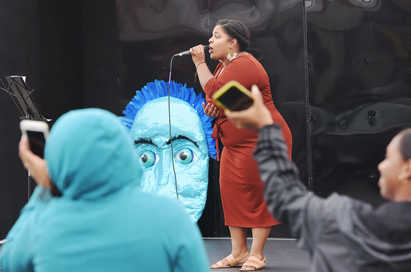 TIM JEAN/Staff photo<br /> <br /> Kelsy Duran, owner of KDRAN Voice Lessons in Lawrence, performs a song on The Wandering Stage, during a Community Spirit celebration at the Stadium Plaza on Winthrop Avenue in Lawrence.   9/14/19