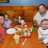 CARL RUSSO/staff photo. READING MAG: The Santos family: A.J. and Miranda of Tewksbury and their children, Benjamin, 2 and Sofia, 5 prepare to have dinner.<br /> <br /> The Lobster Claw, a North Reading family owned restaurant since 1976 was Started by Harry Gresek. His sons, Victor Gresek and Luke Gresek continue the family business after Harry's passing. The two brothers took over three years ago. The restaurant is known for its chowders and sauces and fresh seafood. 9/12/2019 9