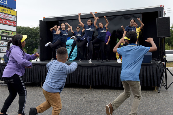 TIM JEAN/Staff photo<br /> <br /> Members of the Lawrence High School Dance Company teach the crowd the steps, as they dance to the energetic hip-hop music on The Wandering Stage, during a Community Spirit celebration at the Stadium Plaza on Winthrop Avenue in Lawrence.   9/14/19
