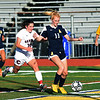 RYAN HUTTON/ Staff photo <br /> Andover's Ava Trapp, right, readies a kick to score against the Central Catholic goal as Central's Katie Regan, left, gives chase during Thursday's game at Andover High School.