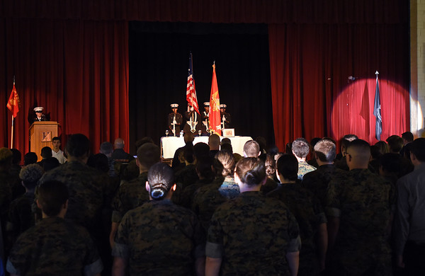 RYAN HUTTON/ Staff photo <br /> The Haverhill High School Marine Corps JROTC cadets perform a POW/MIA remembrance ceremony in the school auditorium on Friday.