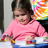 TIM JEAN/Staff photo<br /> <br /> Caitlin Mason, 4, of Andover, creates colorful art at the Kidcasso Art Studio station, during community gathering on the anniversary of the Sept. 13, 2018 gas disaster outside the Old Town Hall in Andover.  9/13/19