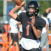 CARL RUSSO/Staff photo. Reggie quarterback, Shamil Diaz looks for the open receiver. Greater Lawrence Tech. defeated Northeast high in Friday football action. 9/20/2019