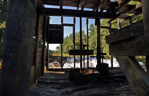 RYAN HUTTON/ Staff photo <br /> A view through the old mill building sitting on the Moeckel Pond Dam which will soon be rebuilt into the new  Marston-Finn Conservation Dam off Moeckel Road.