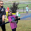 TIM JEAN/Staff photo<br /> <br /> Phoenix Peare, 8, of Salem sprays the fire hose with assistance from Salem firefighter Jared Whalen during the fourth annual Salem Scramble at Salem High School.   9/28/19