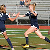 RYAN HUTTON/ Staff photo <br /> Andover's Ava Trapp, right, celebrates with teammate Ashley Kendrigan, left, after scoring on the Central Catholic goal during Thursday's game at Andover High School.
