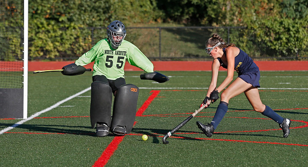 MIKE SPRINGER/Staff photo<br /> Andover's Lily Farnham takes a shot against North Andover goaltender Jenna Bard during varsity field hockey play Wednesday at North Andover. Farnham's attempt missed.<br /> 9/25/2019