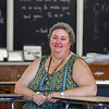 MIKE SPRINGER/Staff photo<br /> Haverhill High School teacher and breast cancer survivor Nancy Burke in her classroom Thursday.<br /> 9/18/2019