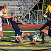 RYAN HUTTON/ Staff photo <br /> Andover's Annabelle Chan slide-kicks the ball past Central Catholic goalkeeper Izzy Majewski, right, and defender Kaleigh Lane, left, to score during Thursday's game at Andover High School.