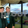 CARL RUSSO/Staff photo Kay Frishman, who serves as a clerk for the AVIS trustees and Dennis Crispo, a warden for the Hammond Reservation have their picture taken wearing their AVIS caps as the sunsets behind the Andover Country Club golf course.  <br /> <br /> The AVIS, Andover Village Improvement Society kicked off its 125th anniversary celebration with the 2019 annual meeting and dinner Wednesday night on April 10 at the Andover Country Club. <br /> <br /> Following the address from the AVIS Board of Trustees a lecture was given by guest speaker, Randolph Wentworth of the Harvard Kennedy School Center for Public Leadership. He is also the president emeritus of the Land Trust Alliance, a national conservation group that serves as leader for 1100 land trusts.  4/10/2019
