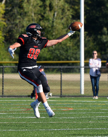 CARL RUSSO/Staff photo. North Andover's Max Wolfgang reaches for the pass but is unable to make the one hand catch. Marblehead defeated North Andover 25-20 in Friday football action. 9/12/2019