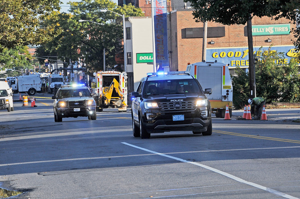 TIM JEAN/Staff photo<br /> <br /> Lawrence police race away from an area on Broadway and Salem St., Friday morning after a reported major gas leak caused a lockdown and evacuation of the South Lawrence.   9/27/19