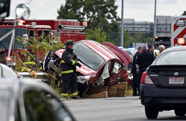 RYAN HUTTON/ Staff photo <br /> Members of the Lawrence Fire Department had to use a hydraulic vise to rescue the driver of a car in the southbound lane of I-495 at the overpass of Massachusetts Ave in Lawrence on Monday afternoon.