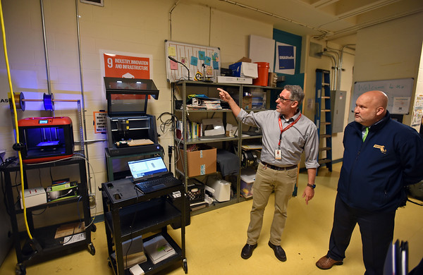 RYAN HUTTON/ Staff photo <br /> Department of Elementary & Secondary Education Jeff Riley, right, listens as Stephen Chinos, Andover's director of strategic innovation shows off the school's 3D printer and CNC machine during Riley's tour of the school on Friday.