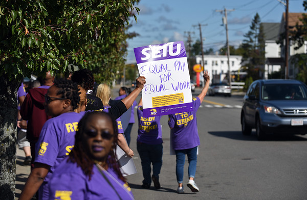 RYAN HUTTON/ Staff photo <br /> Service Employees International Union workers gather outside Fidelity House CRC's Lawrence location on South Union Street during a strike on Wednesday morning.