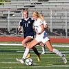 RYAN HUTTON/ Staff photo <br /> Central Catholic's Elizabeth Dankert, right, battles Andover's Ava Trapp, left, for the ball during Thursday's game at Andover High School.