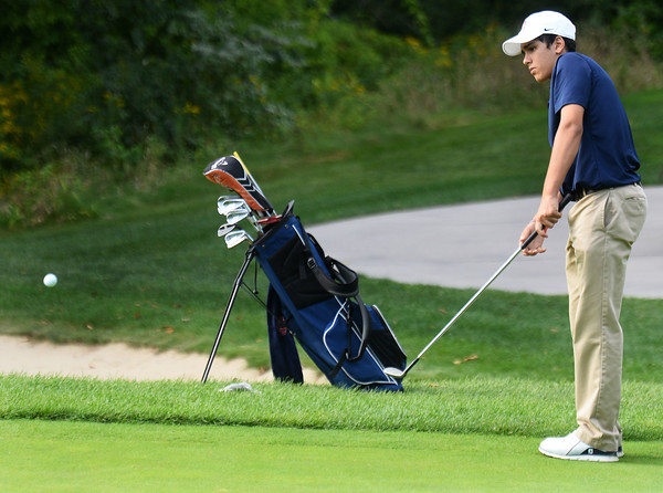 CARL RUSSO/staff photo. Central's Kyle Melo chips it on the green. Andover vs.Central Catholic in golf action at the Renaissance Country Club in Haverhill. 9/17/2019