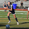 RYAN HUTTON/ Staff photo <br /> Andover's Ashley Kendrigan, left, tries to beat Central Catholic's Elizabeth Dankert, right, to the ball during Thursday's game at Andover High School.