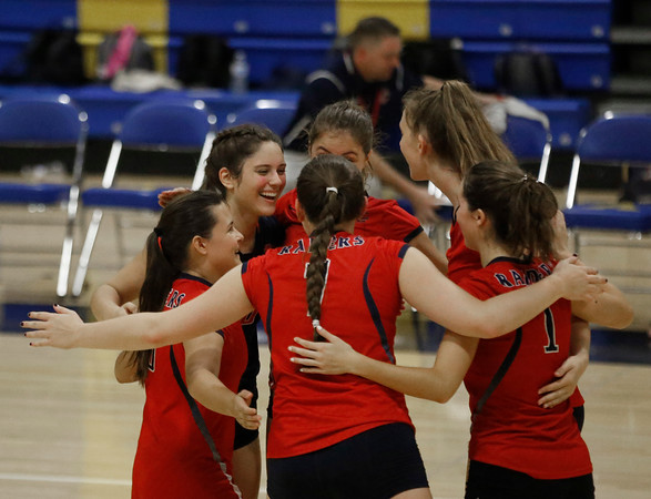 MIKE SPRINGER/Staff photo<br /> Central Catholic players celebrate a point against Andover during varsity volleyball play Monday at Andover.<br /> 9/23/2019