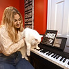 RYAN HUTTON/ Staff photo <br /> Juliana Cervizzi with her cat XXXXX in the recording studio she and her family built in the basement of their Reading home.