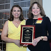 CARL RUSSO/staff photo. Clare Macoul, Enterprise Bank, right, accepts the 2019 Volunteer of the Year award from Donna Morris, President of the Greater Salem Chamber of Commerce at the Greater Salem Chamber of Commerce 31st. Annual Dinner and Awards Ceremony. The event was held at the Brookstone Event Center in Derry Wednesday night.  9/25/2019                       <br /> <br /> Michael Delahanty, Salem School District Administrator; Clare Macoul, Enterprise Bank and Robyn Sweeney-Glickel, Barclay Personnel will all be honored at the 2019 Annual Dinner Meeting and Awards Ceremony on Sept. 25.<br />  <br /> Delahanty is winning the 2019 William A. Brown Business person of the Year Award. <br /> Macoul is winning the 2019 Volunteer of the Year. Sweeney-Glickel is winning the 2019 Chairman's Award. 9/25/2019