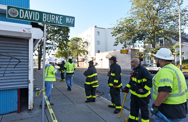RYAN HUTTON/ Staff photo <br /> Gas technicians and Lawrence Firefighters check buildings and manholes for gas in the area of South Broadway and David Burke Way in South Lawrence on Friday after a reported major gas leak caused a lockdown and evacuation of the area.