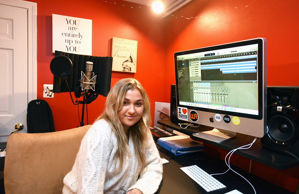 RYAN HUTTON/ Staff photo <br /> Juliana Cervizzi in the recording studio she and her family built in the basement of their Reading home.