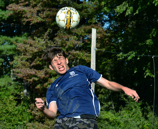 """CARL RUSSO/Staff photo Timberlane senior soccer player, Ryan Boggiatto heads the ball during practice. <br /> <br /> This will be the end of an era for Timberlane boys soccer. Seniors Cameron Ross, Dimitri Kakouris, Matt Barney, Shawn Perry, Ryan Boggiatto and Joe Casey are all the youngest siblings of many who have come through both the boys and girls programs at Timberlane. But for their """"last ride"""" together, the Owls have started the season an undefeated 5-0-2.  9/27/2019"""