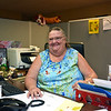 RYAN HUTTON/ Staff photo <br /> Pat Dennehy, director of the Community Action Drop-in Center at her desk on Monday. Dennehy has been working for Community Action for 40 years.