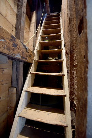 TIM JEAN/Staff photo<br /> <br /> A narrow stairway, more like a ladder leads up towards the historic Revere bell and its tower of the North Andover Meeting House built in 1836.    9/26/19