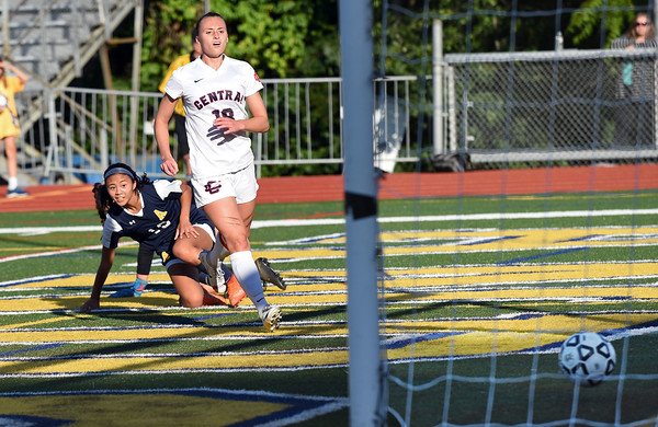 RYAN HUTTON/ Staff photo <br /> Andover's Annabelle Chan watches her shot slide into the Central Catholic goal as Central's Kaleigh Lane looks on during Thursday's game at Andover High School.