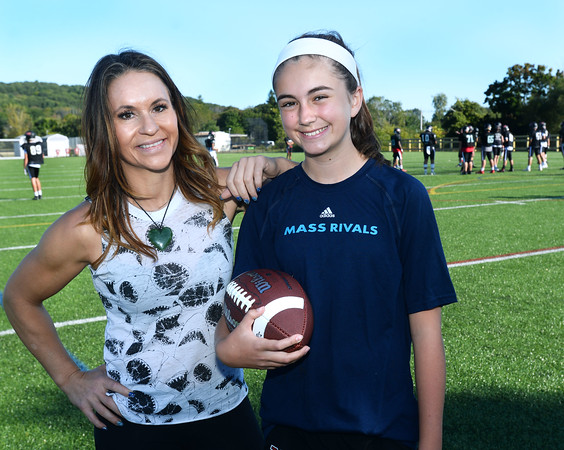 CARL RUSSO/Staff photo. Jen Welter works with Rachel McDevitt, 11, a 6th. grader at the North Andover Middle School, teaching her the fundamentals of football. <br /> <br /> Jen is a former NFL assistant coach who has made it her mission to promote the sport for girls, teaching fundamentals so girls can play and be successful in flag football. As a coach, Jen wants more girls in the sport. 9/19/2019
